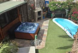 Private garden, heated pool and great hot tub