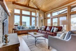 The living room with vaulted ceilings and ocean views