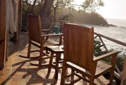 Watch the sunset from the balcony while relaxing in your rocking chairs.
