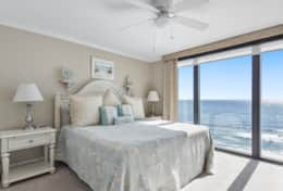 Master bedroom #1 with King bed and large floor to ceiling window to view the ocean