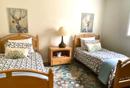 The lower level twin bedroom is a restful oasis