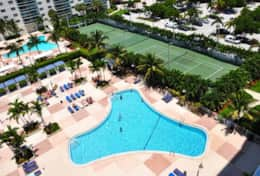 Aerial view of tennis courts & swimming pool area ( not view of apartment)