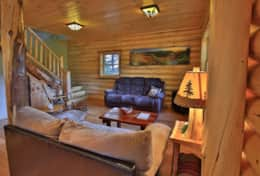 Wilmington Range Chalet living room is very cozy and rustic