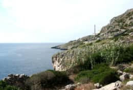 Il Faro - view of the rocky coast and of 'de Finibus Terrae' lighthouse - Leuca - Salento