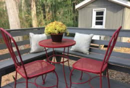 Outdoor seating on front porch, with locked storage area for your bikes and outdoor gear