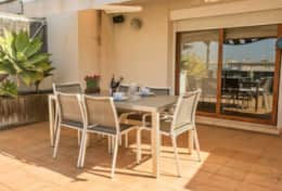 Terrace with dining table Los Condes Apartment