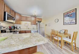 Fully equipped kitchen with all appliances.  Stainless Steel, Granite, new floors