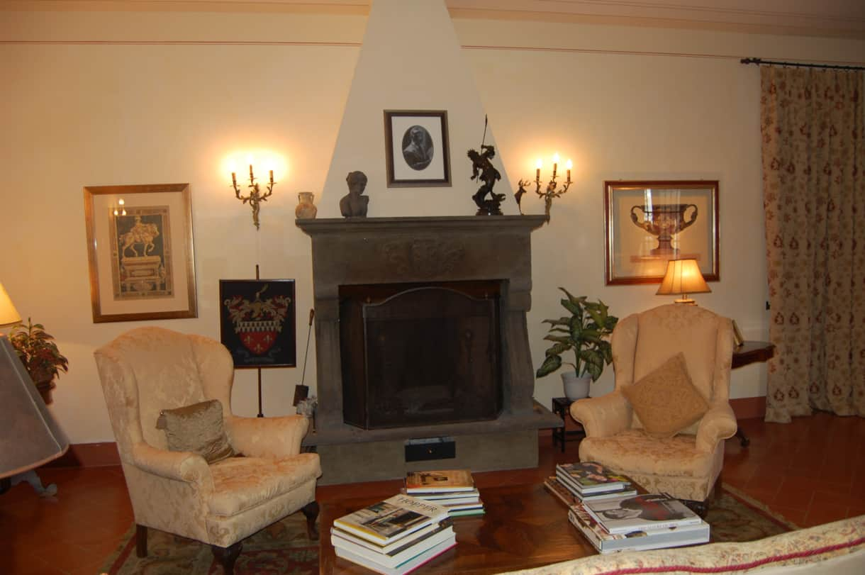 The 18th century working log fireplace in this welcoming villa for rent in Tuscany