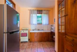 Full kitchen with full refrigerator, large oven, microwave, blender, and more.