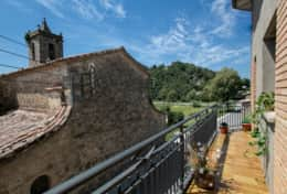 Views of the church and the Castle of Besora from the balcony