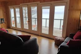 full wall of windows  allow you to see the lake from inside livingroom and kitchen