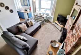 Driftwood Apartment - large living area with large, smart television and sofabed