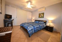 Queen size bed, another TV, exit to balcony