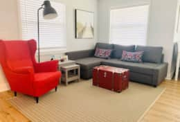 Unit 3 (1 Br / 1 Ba) living room with pull out couch - you bring linens!