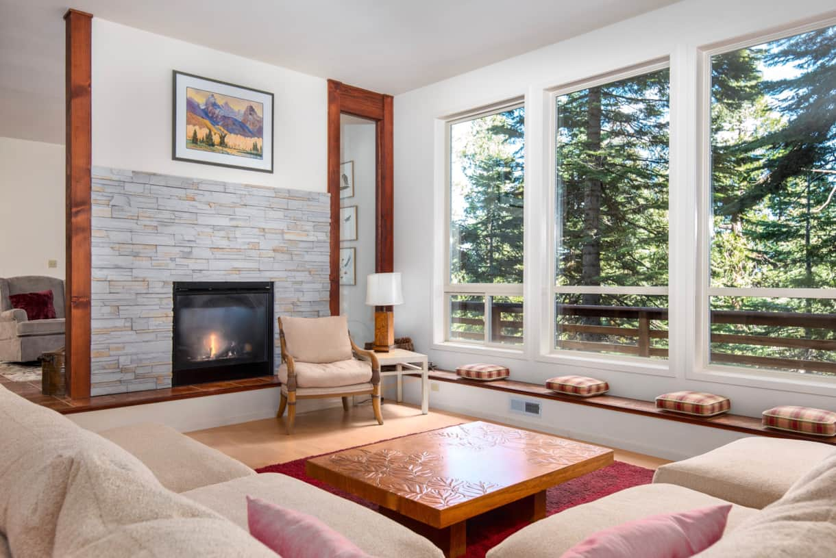 tall windows & double sided gas fireplace