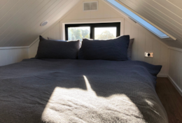 Queen bed loft at tiny house Isabella