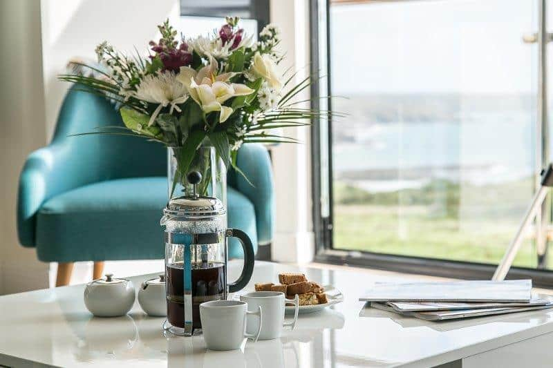 Kennack Heights coffee table with flowers and seaview