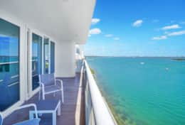 Fully furnished balcony with views of Biscayne Bay and Sea Isles Marina