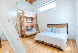 Bunk room with king bed and ensuite bathroom