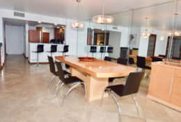Dining area for 6, seating for 3 at kitchen counter, fully equipped kitchen