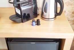 Noiseless mini fridge, Nespresso and kettle in every room
