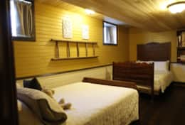 Felix Basement Bedroom - www.oldchurchcottages.com - Boundary Creek,NB Location
