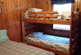 Bedroom with 1 double bed and a set of bunk beds