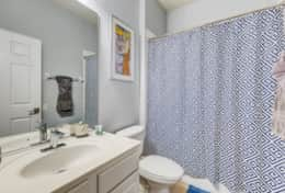 Shared 'Jack-and-Jill' bathroom with access to main house and queen bedroom