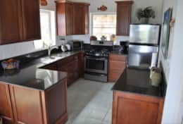 Brand New Gourmet Kitchen with Cherry Cabinets and Granite Countertops