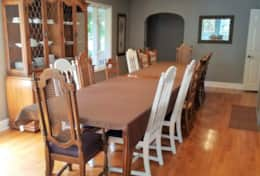 Two dining room tables so everyone can enjoy meals together.