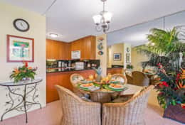 Dining Area set close to kitchen making it great for easy service of meals over the countertop