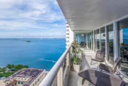 Furnished balcony with views of Biscayne Bay, Margaret Pace Park, Heart Island