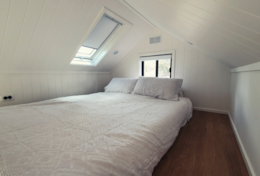 The Queen loft bed at tiny house Robert