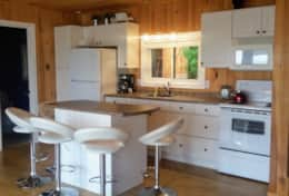 Eat in Kitchen is clean and bright. Fridge,Stove, Microwave  Seating for 5 at the island so you
