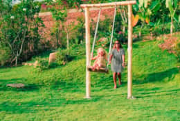 Villa Alila garden with swing