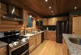 stainless steel appliances and a large fully equipped kitchen