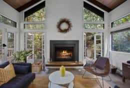 A fireplace in the living room will truly bring you comfort and warmth in any season.