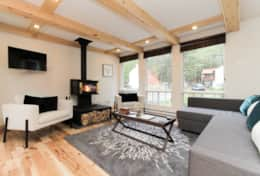 Living Area - Includes dining table, sofa bed, comfy chairs and a wood burning fireplace