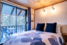Bedroom 3 has a double bed and a private balcony