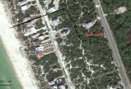 Follow a path from Beach Camp across a quiet neighborhood road to get to the Gulf.  It's about 250yd