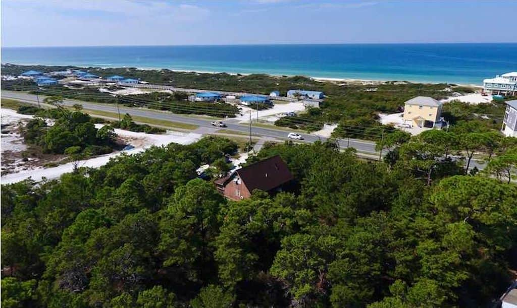Neighborhood Le Grand Merci - Pre-Renovation Aerial View Showing Proximity to Beach