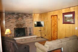 cabin 5 living room smart TV brick fireplace sofa sleeper