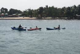 Guests kayaking around the The Enclave