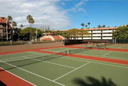 Four tennis courts are awaiting your reservation.