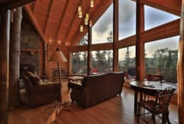 Great Room with big logs and windows