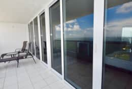 Fully furnished balcony with views of Biscayne Bay and Margaret Pace Park