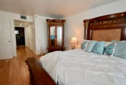 Master bedroom, queen bed, balcony access, Roku tv, walk in closet, private bathroom