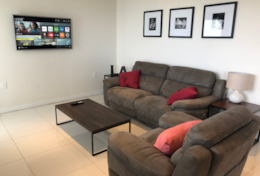 Smart TV in the living room for streaming your favorite series and reclining couch