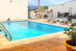 Outdoor swimming pool on shared terrace