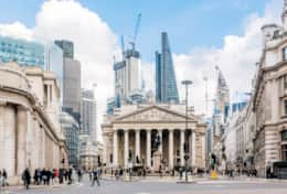 Street in city of london with royal exchange bank of england and new modern skyscrapers england uk 9